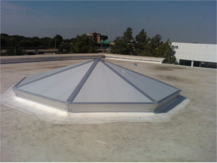 Exterior view of a white pyramid style CPI skylight over a store entrance