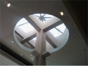 Inside view of a white pyramid style CPI skylight over a store entrance