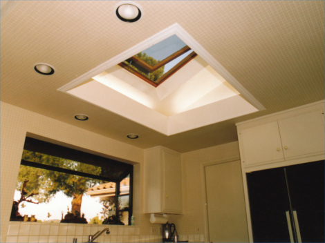 Kithchen interior lit by insulated glass venting skylight