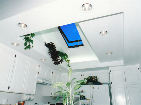 A kitchen interior lit by a vented glass velux skylight