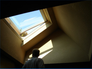 View from inside during sunset of a velux venting insulated glass skylight